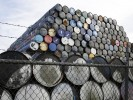 Oil barrels are stacked at a storage facility in Seattle, Washington
