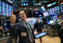 Wall Street Hit By Apple Slide, Trade Woes