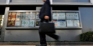 Asian Stocks Slide, Investors Rush To Yen And Bonds