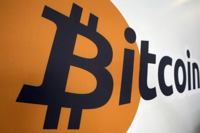A Bitcoin logo is displayed at the Bitcoin Center New York City in New York's financial district July 28, 2015. China's central bank launches spot checks on bitcoin exchanges