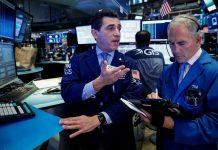 Wall Street flat; financials drop ahead of earnings