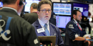 Wall St. Holds On To Gains; Fed Policy Meeting Eyed