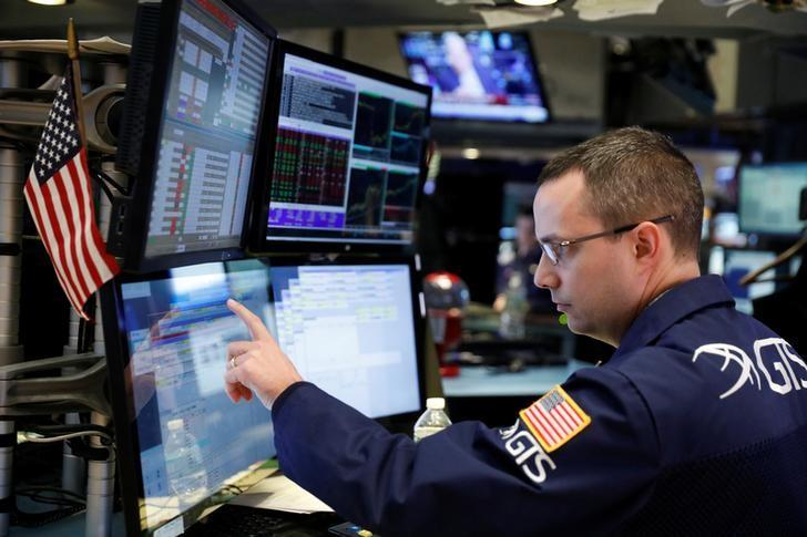 Wall St. lower as Fed uncertainty weighs on bank stocks