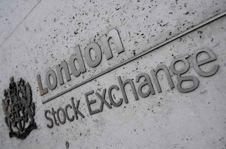 World Shares Cling Near Record Highs