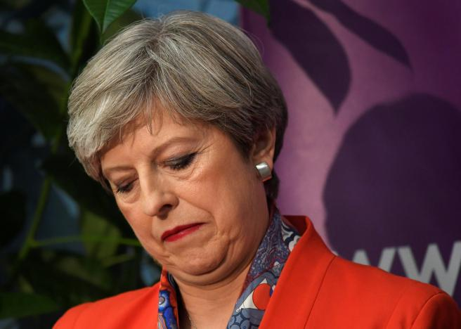 Britain's Prime Minister Theresa May waits for the result of the vote in her constituency at the count centre for the general election in Maidenhead,